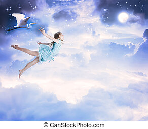 Little girl flying into the blue night sky with white egret