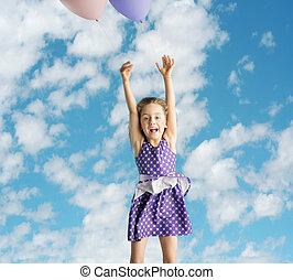 Little girl flying up to the sky