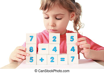 Little girl folds equalizations from cube