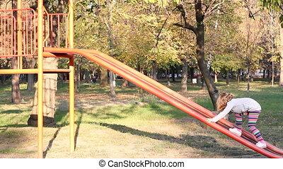 little girl fun on playground slide