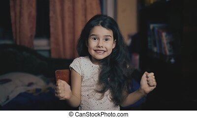 little girl gesture yes thumb up emotion of joy and success...