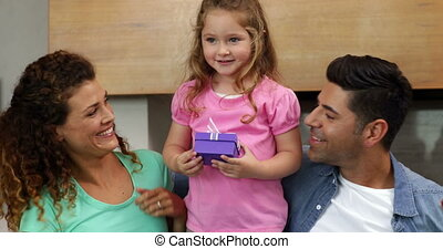 Little girl giving a gift to her mother