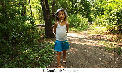 little girl goes on forest after chamber in summer