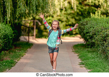 Little girl going home after school