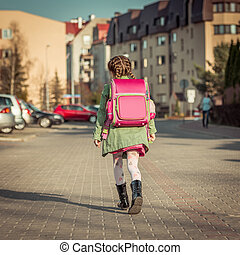little  girl going to school