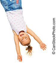 Little girl hanging upside down