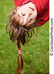 Little girl hanging upside-down - Sweet little girl with...