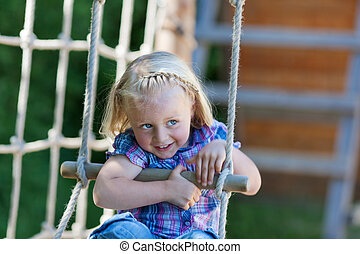 Little girl has fun at playground - Little girl is enjoying...