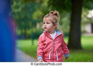 little girl have fun in park
