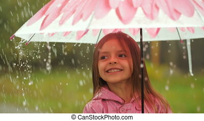 Little Girl Having a Fun Under Rain