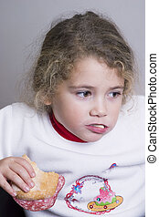 little girl having a sandwich