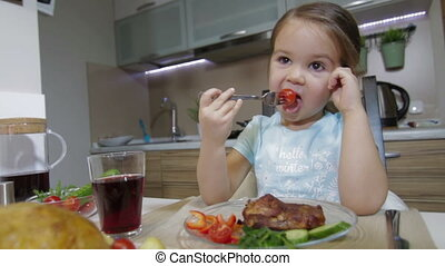 Little girl having family dinner