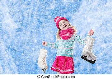 Little girl having fun at ice skating in winter - Happy ...