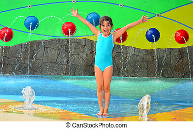 Little girl having fun in Cairns Esplanade public water park in Queensland Australia