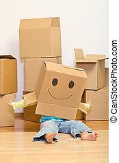 Little girl having fun in her new home unpacking