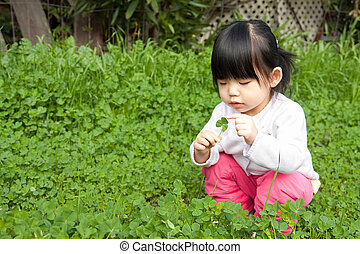 Little girl having fun in park