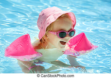 little girl having fun in the pool