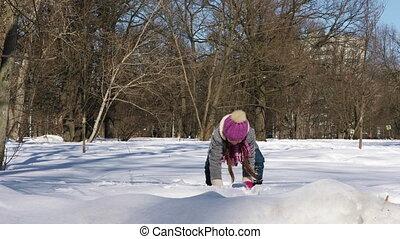 Little girl having fun in winter city park - Little girl...