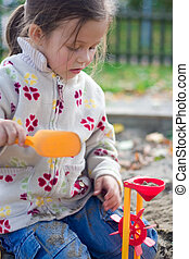 little girl having fun on a playground
