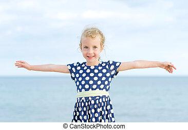 Little girl having fun on beach vacation