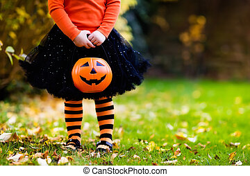 Little girl having fun on Halloween trick or treat - Little...