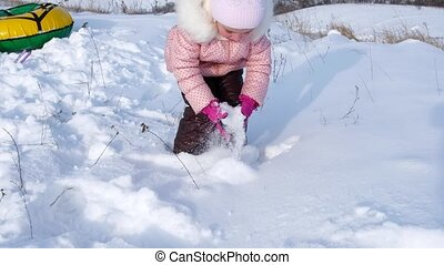 Little girl having fun with snow