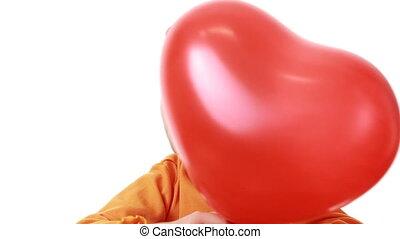 little girl hiding behind heart shaped balloon - cute little...