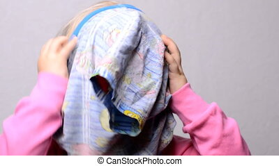 Little Girl Hiding Face in a Dress, Closeup