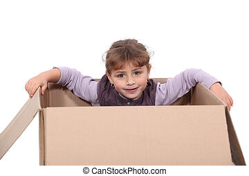little girl hiding in a box