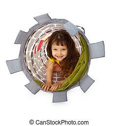 Little girl hiding inside the basket