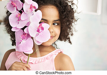 Little girl holding a beautiful flower