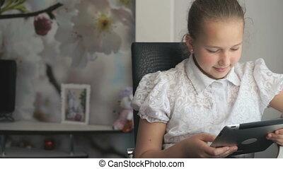 Little girl holding a digital tablet computer