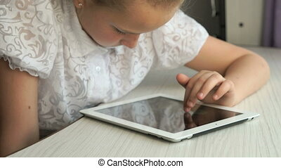 Little girl holding a digital tablet computer