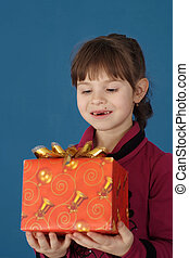 Little girl holding a gift