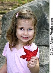 Little girl holding a leaf