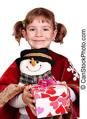 little girl holding a present