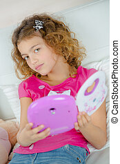 Little girl holding a toy electrical device