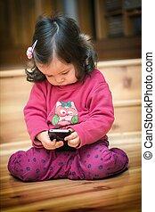 Little girl holding cell phone