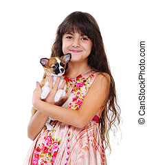little girl holding chihuahua puppy