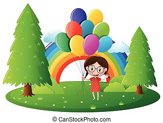 Little girl holding colorful balloons in park