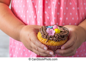 Little Girl Holding Easter Cupcake