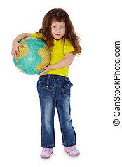Little girl holding globe isolated on white