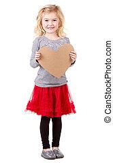 Little girl holding heart - Little girl holding brown...