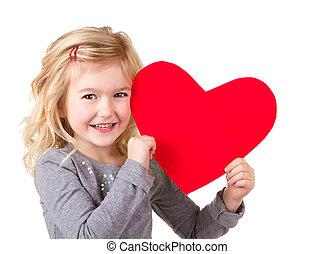 Little girl holding heart - Little girl holding red heart,...