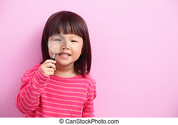 little girl holding magnifying