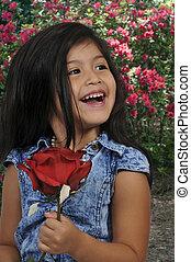 Little Girl Holding Rose