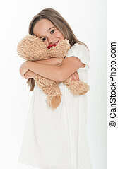 Little girl holding teddy bear