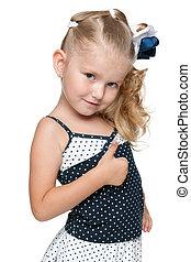 Little girl holds her thumb up