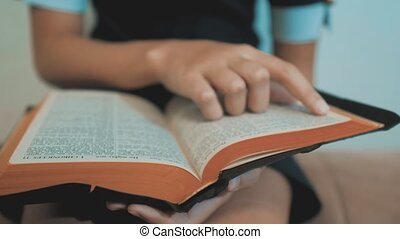 little girl holy bible prays with bible in her hands. the catholicism sacred holy bible. children and lifestyle religion upbringing faith symbol . Little girl with praying . Peace , hope, dreams concept