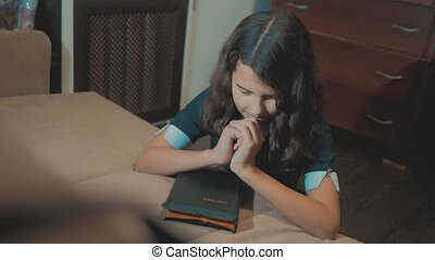 little girl holy bible prays with bible lifestyle in her...